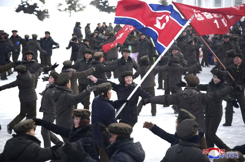 """In this Monday, Dec. 2, 2019, photo provided Tuesday, Dec. 3, 2019, by the North Korean government, people dance to celebrate the completion of Samjiyon city. On Monday, North Korean leader Kim Jong Un visited Samjiyon county at the foot of Mount Paektu to attend a ceremony marking the completion of work that has transformed the town to """"an epitome of modern civilization,"""" KCNA said. It said the town has a museum on the Kim family, a ski slope, cultural centers, a school, a hospital and factories. Independent journalists were not given access to cover the event depicted in this image distributed by the North Korean government. The content of this image is as provided and cannot be independently verified. Korean language watermark on image as provided by source reads: """"KCNA"""" which is the abbreviation for Korean Central News Agency. (Korean Central News Agency/Korea News Service via AP)"""