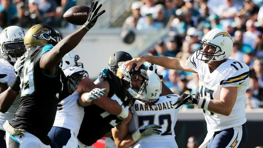 Chargers quarterback Philip Rivers threads a pass through the Jaguars pass rushers during a victory in Jacksonville on Sunday.