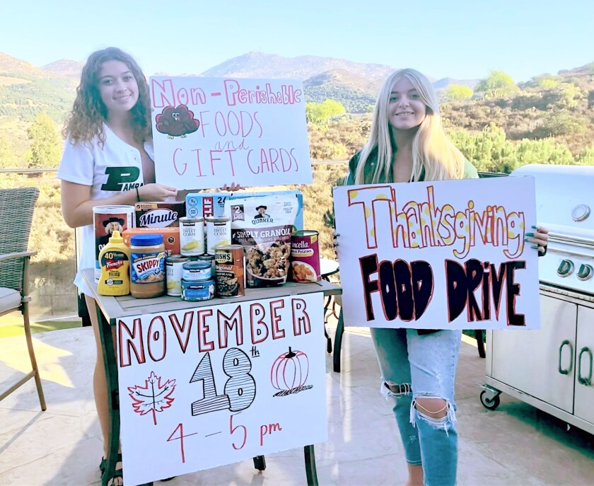 Poway High students Kelly Couvrette and Rosie D'Acquisto are among those volunteering with Chaparral Elementary's food drive.