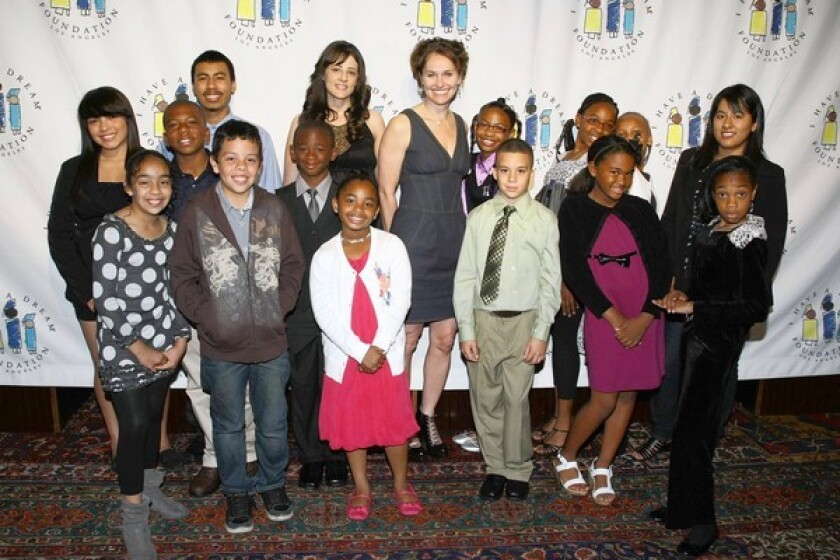 """Amy Brenneman with participants in """"I Have a Dream"""" Foundation-Los Angeles programs. Brenneman hosted the foundation's annual gospel brunch and fundraiser at the House of Blues."""