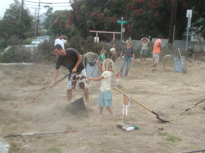 Neighborhood volunteers clean up and work to prepare the lot that would later become the South Laguna Community Garden Park.