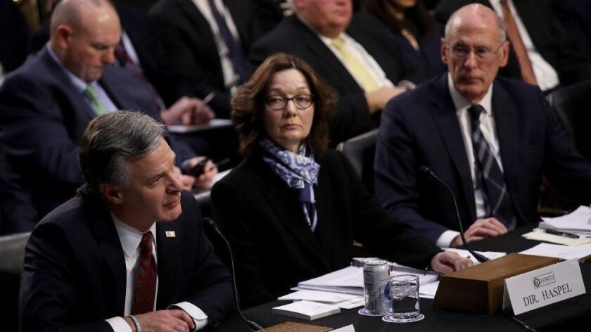 FBI Director Christopher Wray speaks during Jan. 29 testimony to the Senate Intelligence Committee as CIA Director Gina Haspel and Director of National Intelligence Dan Coates listen.