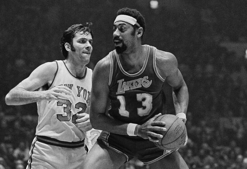Lakers star Wilt Chamberlain looks to pass during a game against the New York Knicks in February 1972.
