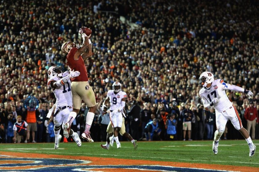 Florida State's Kelvin Benjamin catches the touchdown pass that cost Mark Skiba $50,000.
