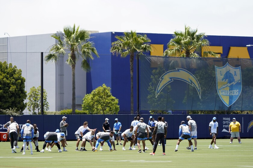 Chargers players take part in organized team activities at the team's practice facility in Costa Mesa on Tuesday.