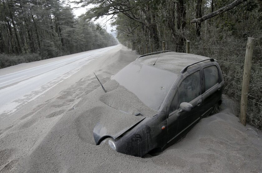 A vehicle near Ensenada in southern Chile is covered with ashes after the eruption of the Calbuco volcano.