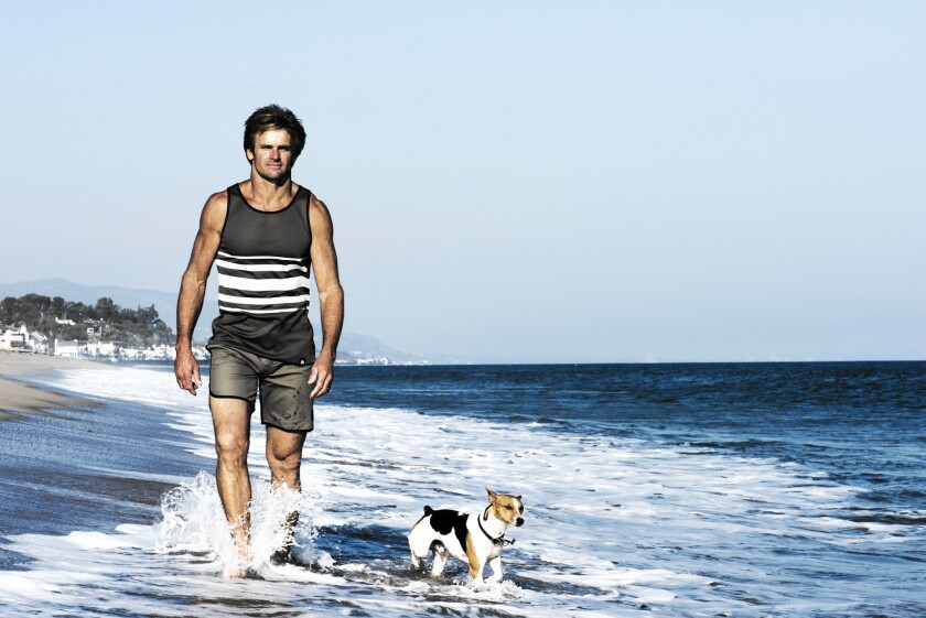 Surfer Laird Hamilton models a Reverso shirt from his new clothing line, Laird Apparel.