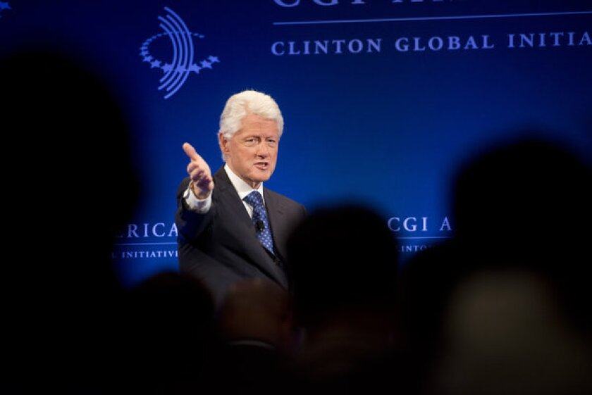 There's a precedent President Obama can follow in his approach to Syria known as the Aspin Doctrine, named after President Clinton's first secretary of defense, Les Aspin. The doctrine states that military intervention doesn't have to be a slippery slope as long as you keep the option of walking away. Above: At the Clinton Global Initiative in Chicago, Clinton applauded the White House decision to help Syrian rebels.