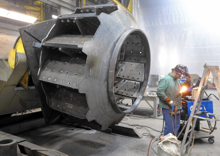 A worker welds parts at Robinson Fans Inc. in Harmony, Pa., in February. Wage growth should accelerate as the labor market improves, giving workers more money to spend, an analyst said.