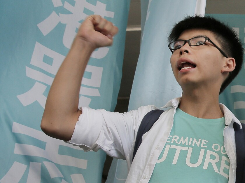 Teen protest leader Joshua Wong outside the magistrate's court in Hong Kong, where he was found guilty of taking part in an illegal rally that sparked massive pro-democracy protests two years ago.