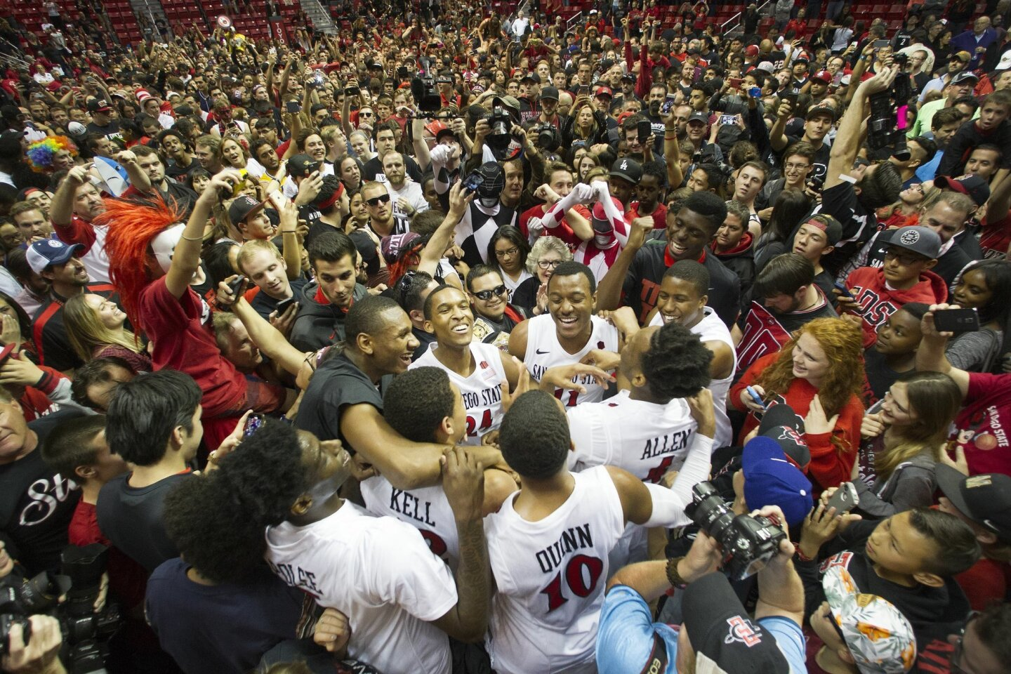 San Diego State vs. Nevada Men's Basketball at Viejas Arena. Fans storm the floor after the Aztecs beat Nevada 67-43 securing a tie of the Mountain West Conference Title with Boise State.