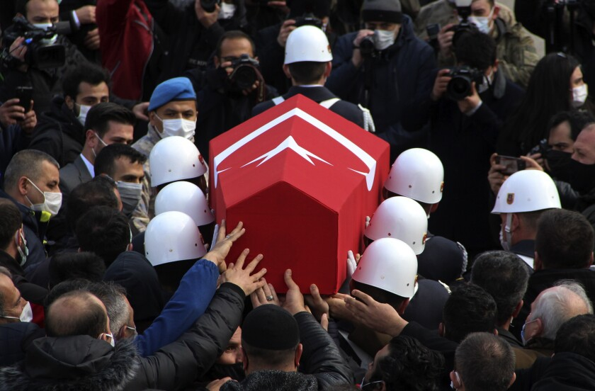 Turkish soldiers carry the national flag-draped coffin of Turkish soldier Er Sedat Sorgun, one of thirteen soldiers, police and civilians who had been abducted by Kurdish insurgents and found killed in northern Iraq, during the funeral in the city of Erzurum, Turkey, Monday, Feb. 15, 2021. Turkish President Recep Tayyip Erdogan vowed on Tuesday to expand cross-border operations against Kurdish militants in northern Iraq, following the killings. (IHA via AP)