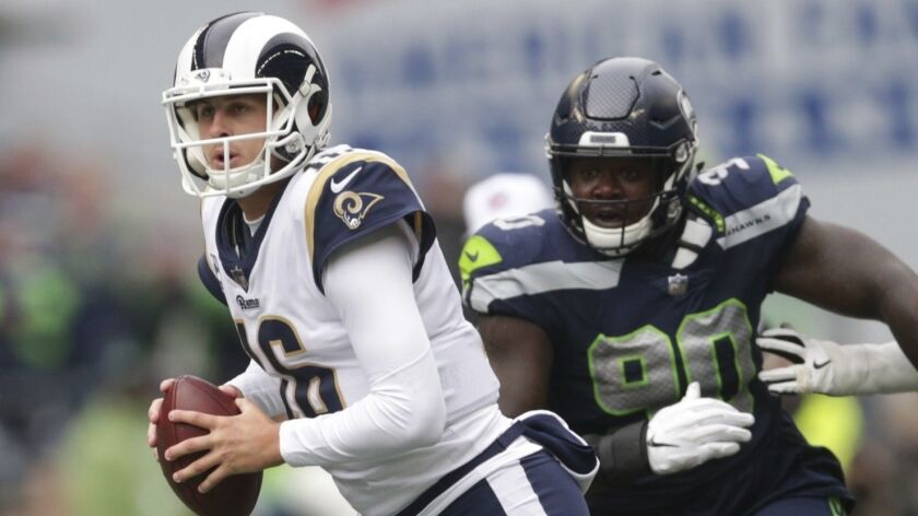 Los Angeles Rams quarterback Jared Goff scrambles against the Seattle Seahawks during the first half