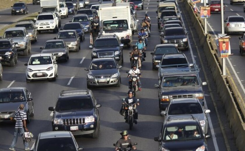 Commuters wait in heavy traffic on a main highway in Caracas. Venezuela, one of the many destinations for record fuel exports from U.S. refineries.