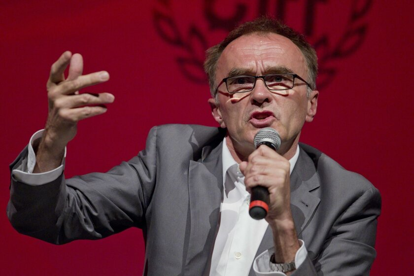 """FILE - In this Thursday, July 25, 2013, file photo, British film director Danny Boyle speaks during a conference at the International Film Festival in Guanajuato, Mexico. Danny Boyle admits """"Steve Jobs"""" is a hard sell. The film about the Apple co-founder got disappointing figures when it opened acr"""