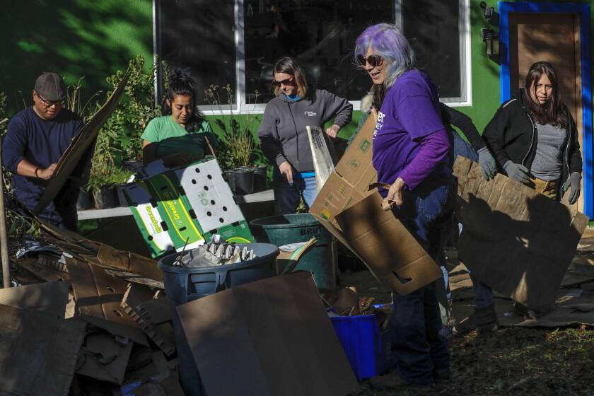 Leigh Adams helps workshop attendees sort through cardboard.