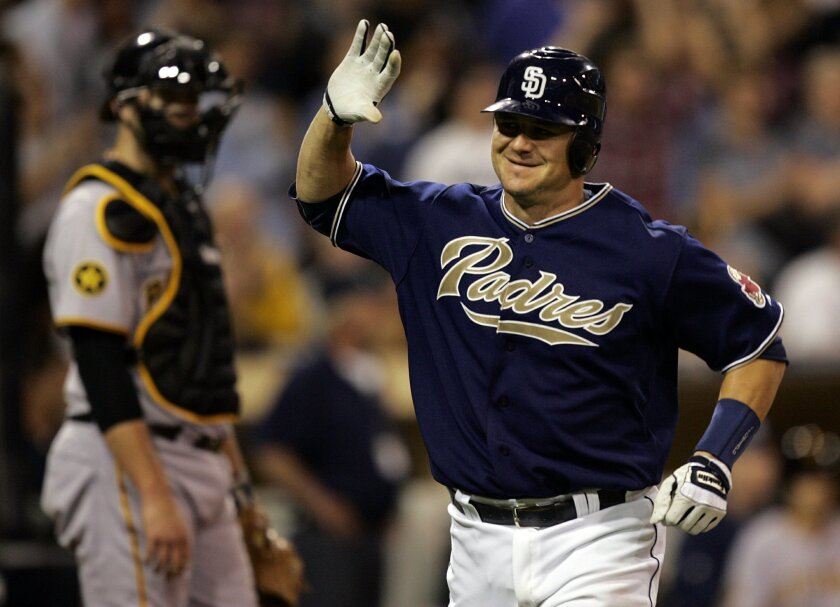 Padres catcher Rob Johnson savors his home run that put San Diego ahead of the Pirates in the eighth inning.