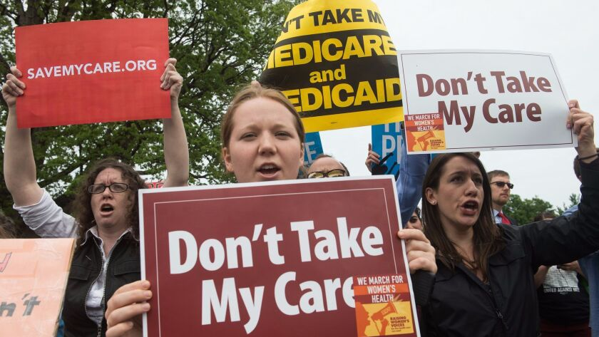 Protesters outside the U.S. Capitol on May 4, 2017, after the House of Representatives narrowly passed a bill to replace Obamacare.