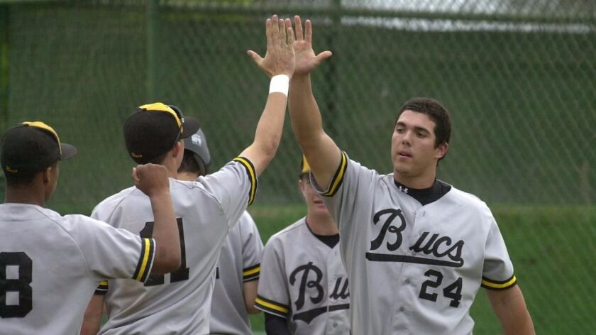 Mission Bay's HENRY SANCHEZ high 5's teammates after scoring, he had gotten a hit earlier then was d