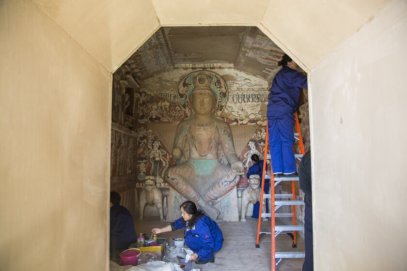 In the weeks before the exhibition opening, artists put finishing touches on the re-created Mogao Grottoes at the Getty Center.