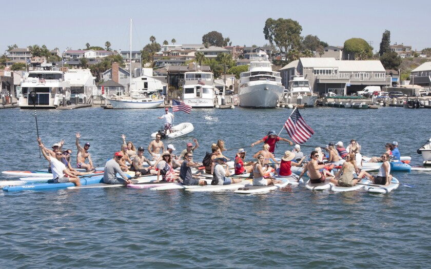 """""""Paddle for Patriots"""" held on September 11 in Newport Bay in memory of the soldiers lost in the evacuation from Afghanistan."""