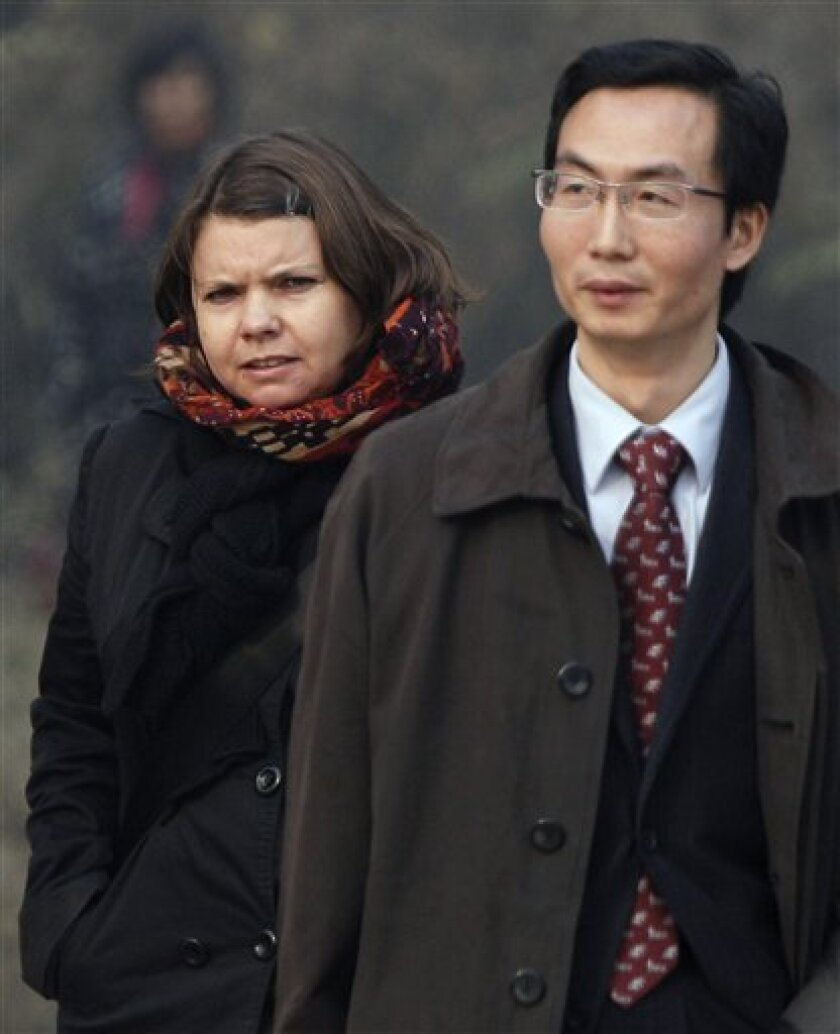 Karen Patterson of Canada, wife of Chinese artist Wu Yuren, left, walks with her lawyer Li Fangping after attending her husband's trial at the Wenyuhe Court in Beijing, China Wednesday, Nov. 17, 2010. Wu was detained and charged after he helped organize protests near Tiananmen Square against some u