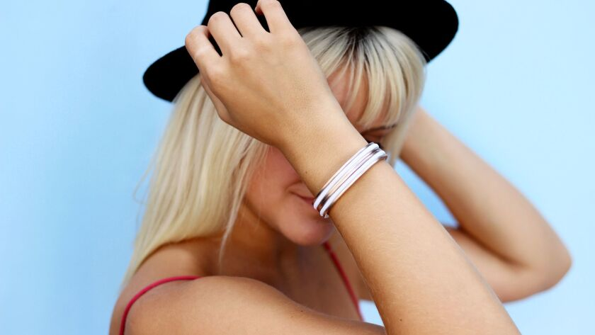 A nifty stocking stuffer - or small gift - is a sleek hair tie bracelet from San Diego brand Marie S