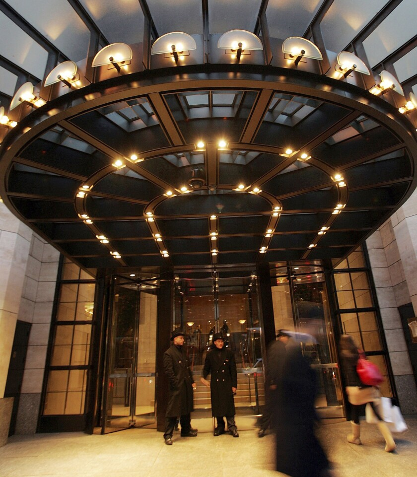 People walk by the Four Seasons Hotel in New York City.
