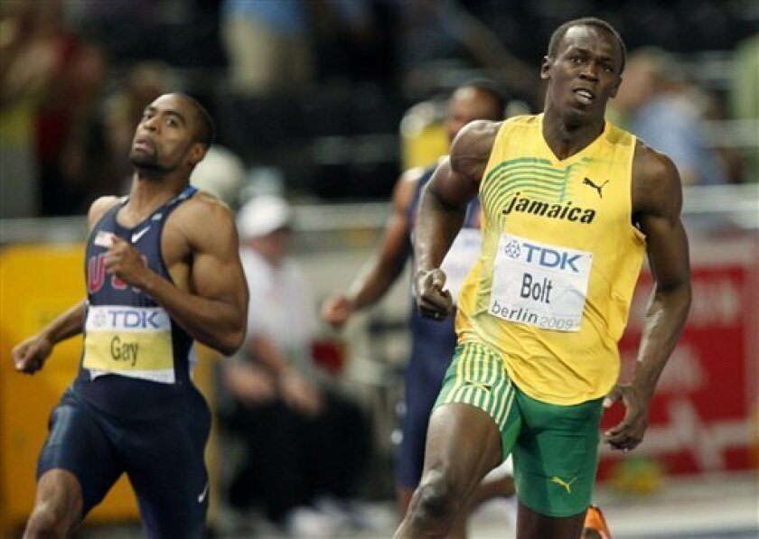 Jamaica's Usain Bolt reacts after winning the final setting a new 100m World Record  during the World Athletics Championships in Berlin on Sunday, Aug. 16, 2009. Left is United States' Tyson Gay. (AP Photo/Michael Probst)