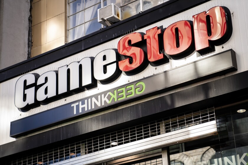 FILE - This Jan. 28, 2021, file photo, shows a GameStop store in New York. GameStop, the video-game retailer whose manic stock movements captivated Wall Street this year, said Wednesday, June 9, 2021, it's brought on a pair of Amazon veterans as its new chief executive and chief financial officer to aid in its much anticipated digital turnaround. (AP Photo/John Minchillo, File)