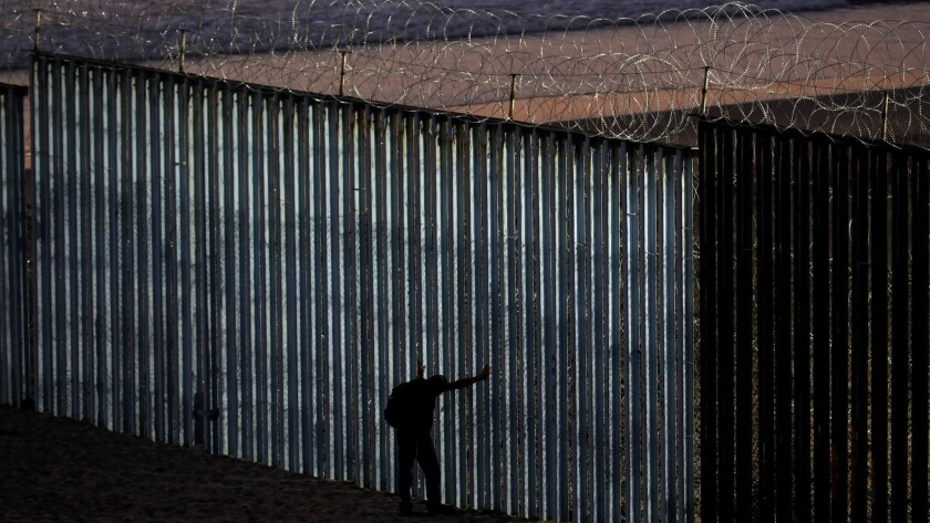 TIJUANA, BAJA CALIF. -- TUESDAY, NOVEMBER 20, 2018: The border wall is fortified with concertina wir