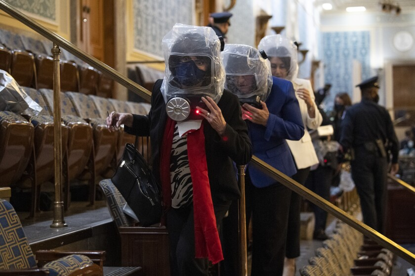 Congressional representatives wore evacuation masks and took cover during Jan. 6 siege of the Capitol