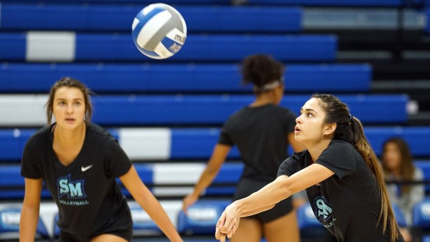 Cal State University San Marcos volleyball player Ashley Pedersen (right). CSUSM Athletics photo