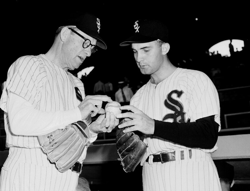 FILE - In this Aug. 10, 1954 file photo, Chicago White Sox pitcher Billy Pierce, right, compares grips with former White Sox Ed Walsh, 73, as an all-star team of White Sox old timers gathered to play an exhibition game before a White Sox-Baltimore Orioles game in Chicago. Pierce, a seven-time All-Star pitcher who played in two World Series and retired after spending most of his 18 years in the majors with the Chicago White Sox, died Friday, July 31, 2015, after a battle with gall bladder cancer. He was 88. (AP Photo/File)