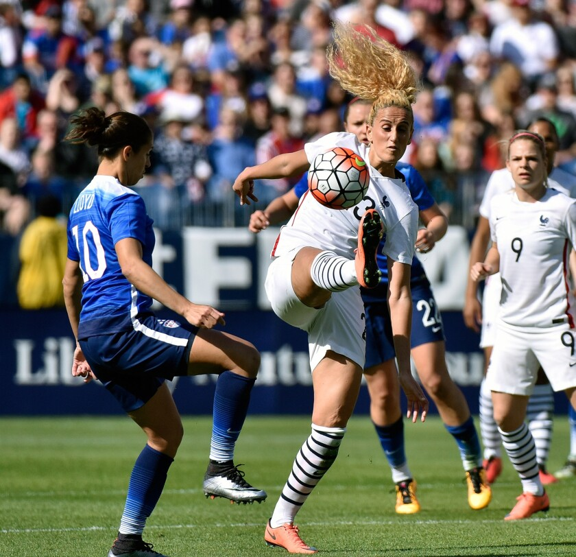 Carli Lloyd (10) of the United States watches as Kheira Hamraoui (23) of France kicks a ball during an international friendly match of the SheBelieves Cup on March 6.