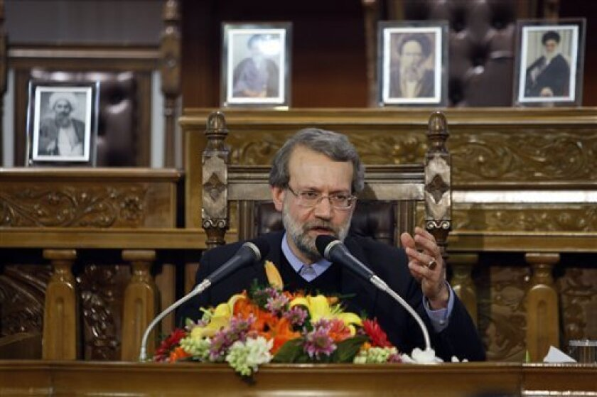 Iranian parliament speaker Ali Larijani, seen, during a press conference in the parliament, in Tehran, Iran, Monday, Nov. 30, 2009. Iran approved plans Sunday to build 10 industrial scale uranium enrichment facilities, a dramatic expansion of the program in defiance of U.N. demands it halt enrichme