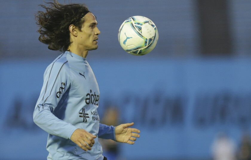 FILE - In this file photo dated Tuesday, Nov. 17, 2020, Uruguay's Edinson Cavani warms up prior to a qualifying soccer match for the FIFA World Cup Qatar 2022 against Brazil at the Centenario stadium in Montevideo, Uruguay. Manchester United striker Edinson Cavani was banned for three games and fined by the English Football Association on Thursday Dec. 31, 2020, after using a Spanish term for Black people which he said was intended as an affectionate greeting. (AP Photo/Matilde Campodonico, Pool - FILE)