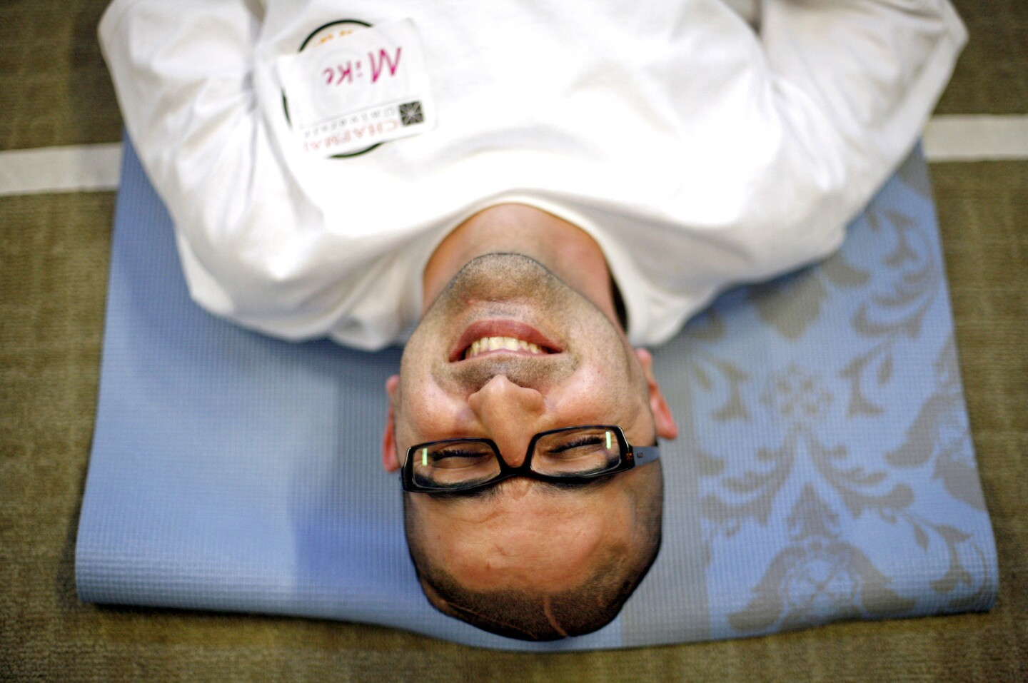 """Mike Nojavan, who was 34 when he suffered a hemorrhagic stroke in 2011, relaxes at the end of a yoga class at Chapman University's Stroke Boot Camp. """"The life I had before my stroke? I knew I couldn't get that life back. So I decided to get a life I could have,"""" he says."""