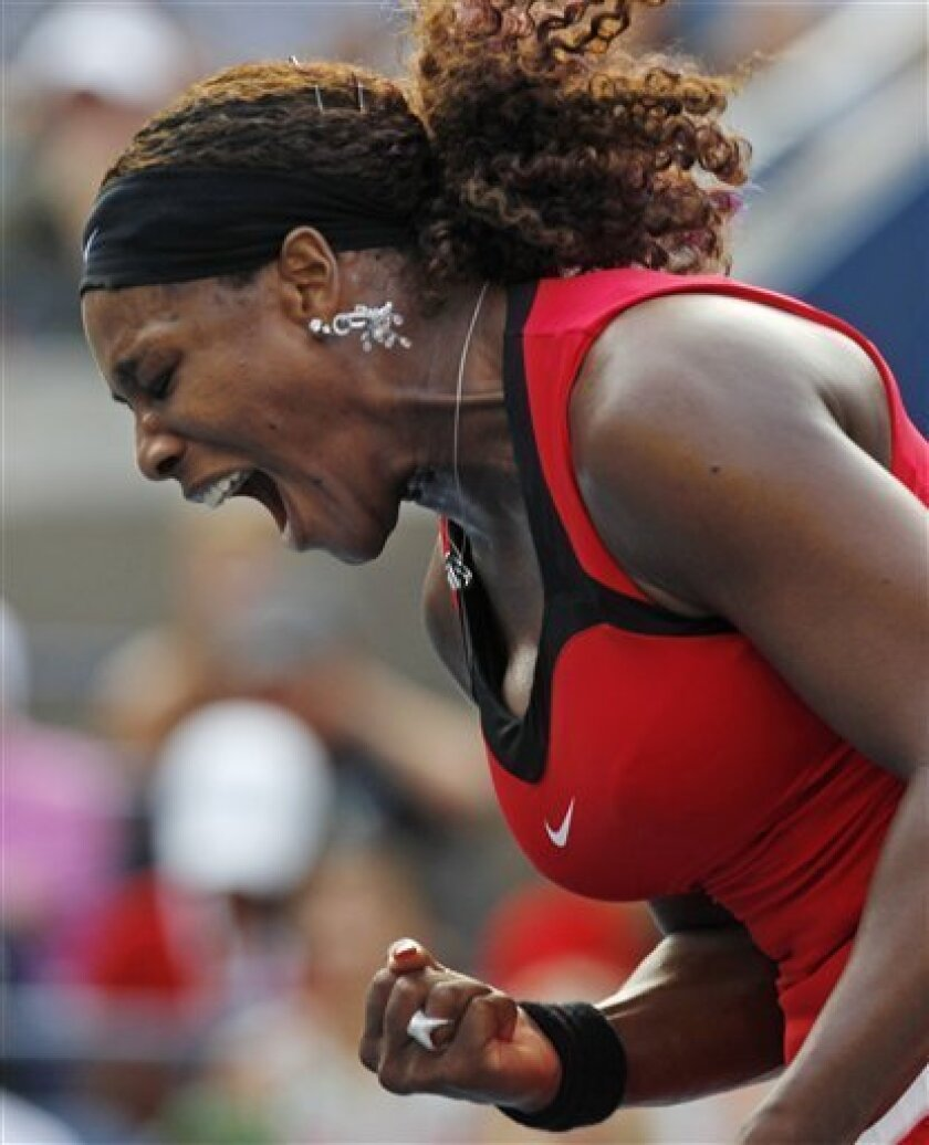 Serena Williams reacts during her match against Victoria Azarenka of Belarus during the U.S. Open tennis tournament in New York, Saturday, Sept. 3, 2011. (AP Photo/Mike Groll)