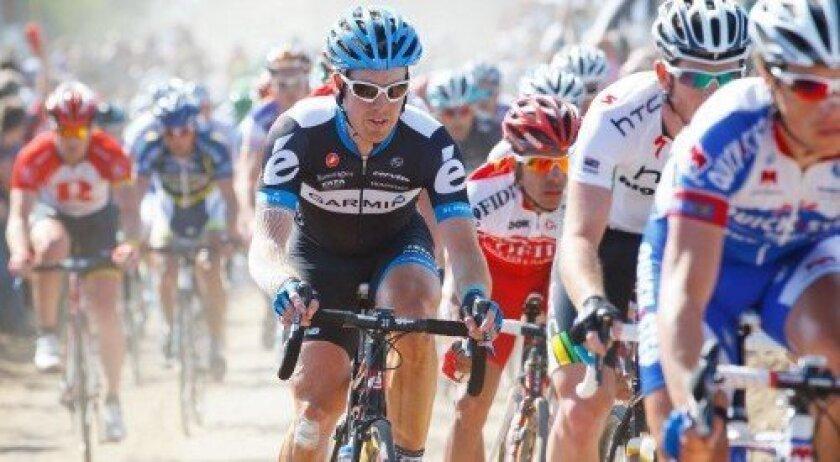 Tyler Farrar rides through cobble sector 27 in Inchy, France, during the 2011 Paris-Roubaix.