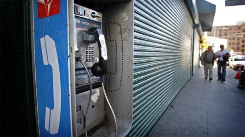 AT&T says it plans to end its dwindling pay phone business by the end of 2008, as more consumers use mobile phones.