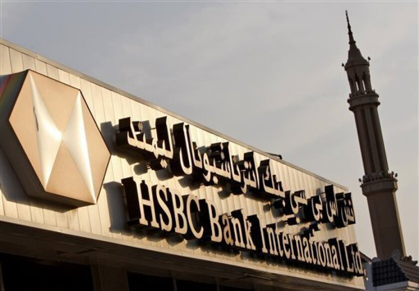 A minaret is seen behind a branch of HSBC bank in Dubai, United Arab Emirates, Monday, Nov. 30, 2009. The heavily indebted Dubai World is not guaranteed by the emirate's government, a top financial official from the city state said Monday, offering little direction to anxious investors on a day whe