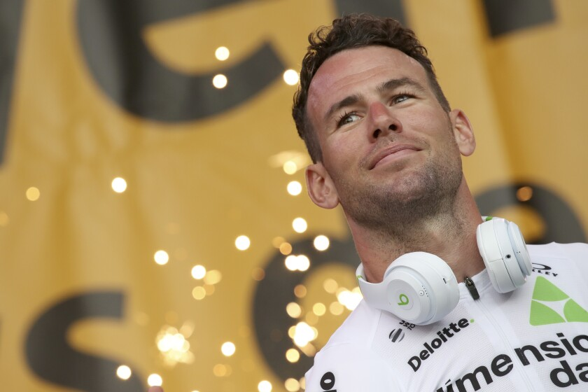 FILE - In this Thursday, July 5, 2018 file photo, Britain's sprinter Mark Cavendish listens during the Tour de France cycling race team presentation in La Roche-sur-Yon, Vendee region, France, ahead of Saturday's start of the race. Veteran sprinter Mark Cavendish will make his return to the Tour de France after a three-year absence from cycling's biggest event, his team said on Monday June 21, 2021. (AP Photo/Christophe Ena, File)