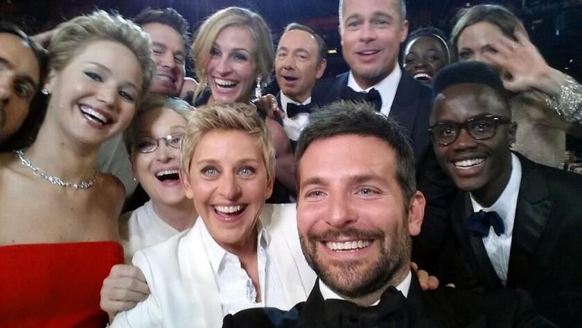 Stars pose with host Ellen DeGeneres for an Oscars selfie.