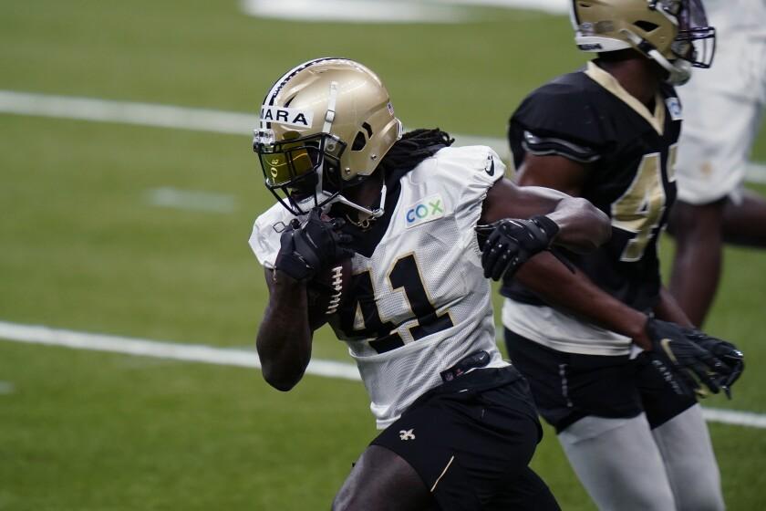 New Orleans Saints running back Alvin Kamara (41) runs through drills during NFL football practice in New Orleans, Thursday, Sept. 3, 2020. (AP Photo/Gerald Herbert, Pool)
