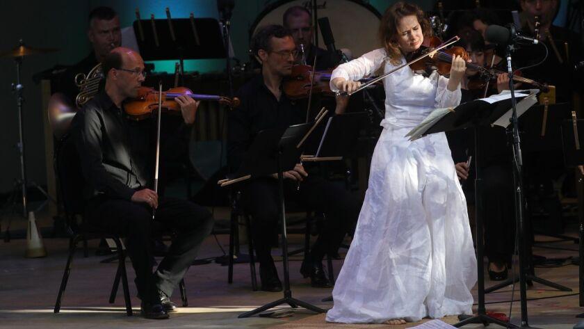 OJAI, CA - JUNE 10, 2018 - Violinist Patricia Kopshinskaja, in white dress, performs with the Mahler