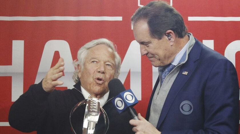 New England Patriots owner Robert Kraft talks to CBS' Jim Nantz after receiving the Lamar Hunt Trophy following his team's win over the Kansas City Chiefs in the AFC championship game on Jan. 20.