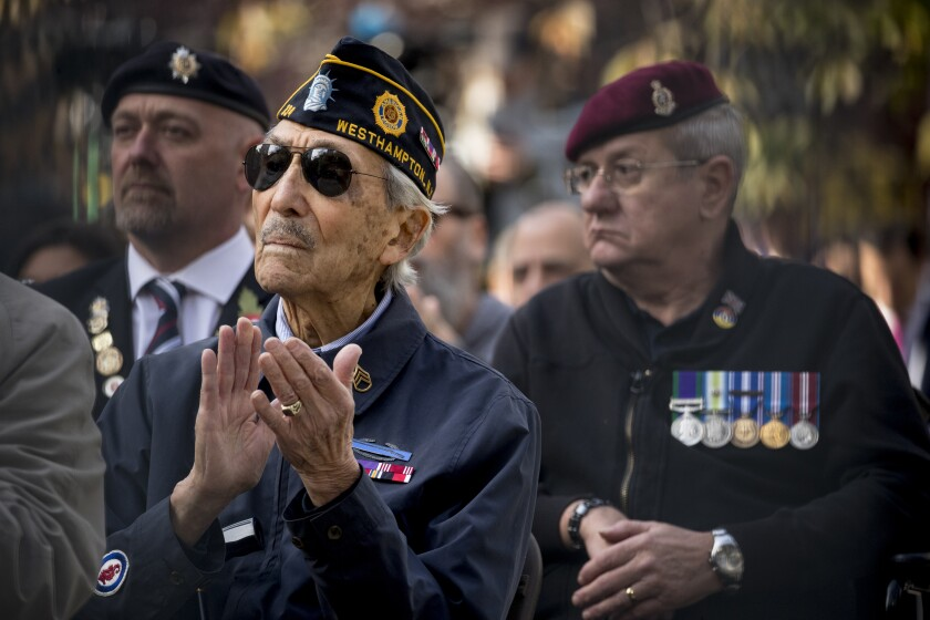 Veterans listen as President Trump speaks at a wreath laying ceremony at the New York City Veterans Day Parade on Nov. 11.