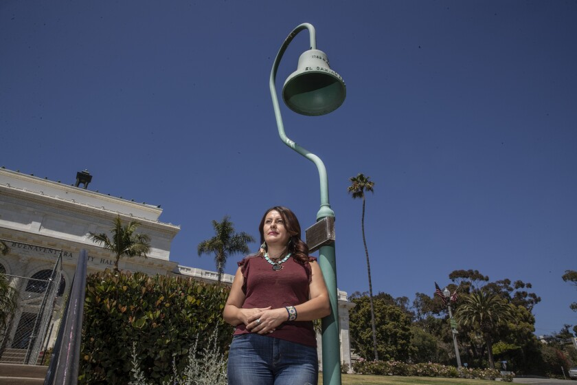Veronica Valadez, 46, stands near where a statue of Father Junípero Serra once stood in front of Ventura City Hall.