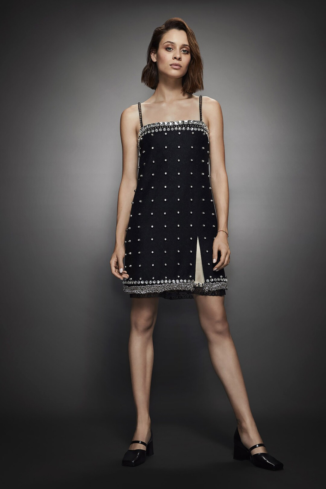 A portrait of a woman in a black dress with white dots on it